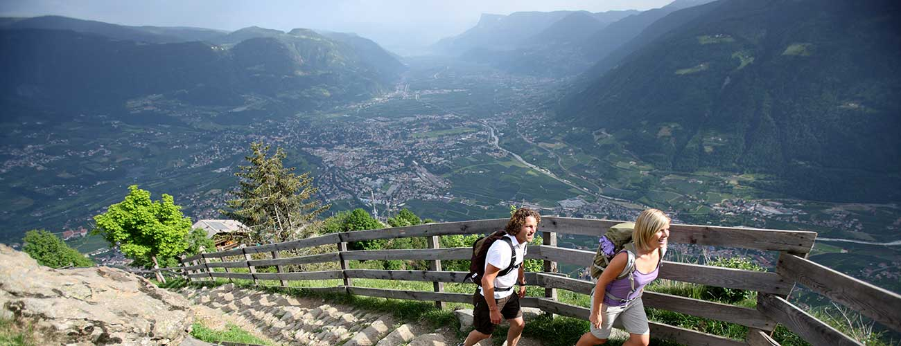 Man and woman hiking in the mountains around Merano