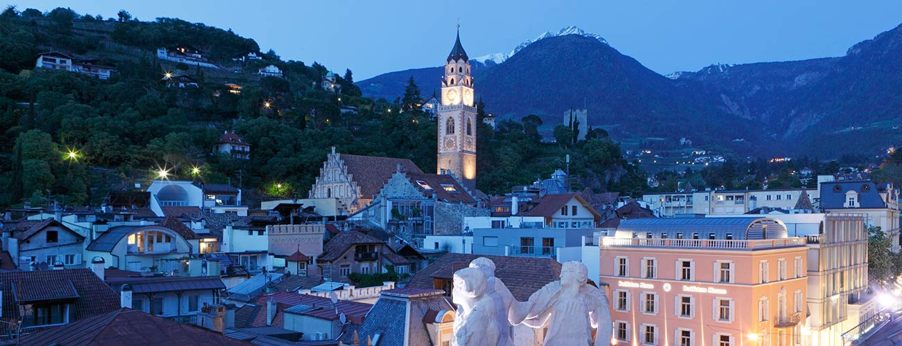 A view of the city of Merano in the evening